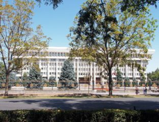 Large white building in Stalinist modern style. This is the White House in Bishkek, Kyrgyzstan.