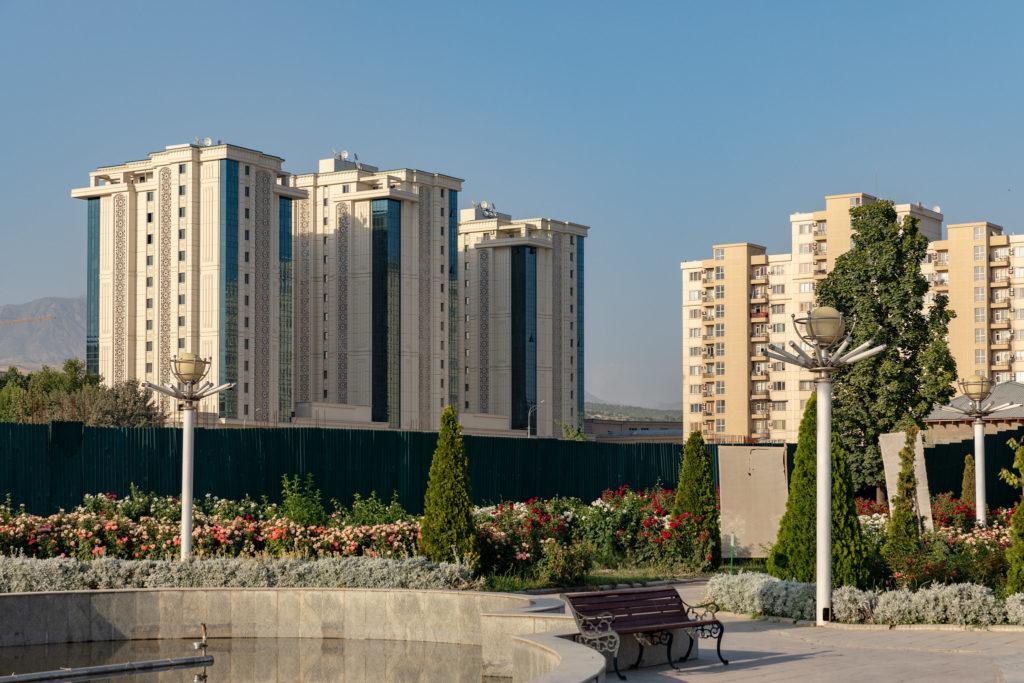 Modern buildings in Dushanbe, Tajikistan, seen from a park