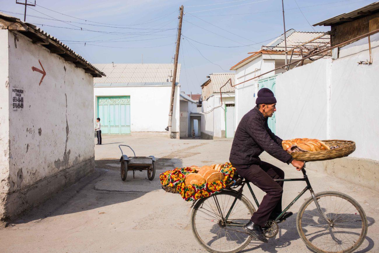 Uzbekistan Fergana Margilan bicycle bread seller