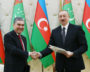 The presidents of Turkmenistan and Azerbaijan shaking hands