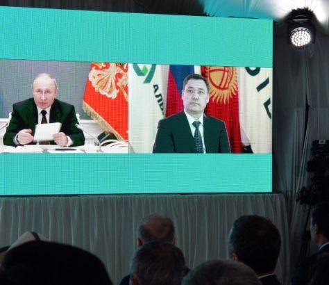 A large screen shows Sadyr japarov and Vladimir Putin speaking via video link