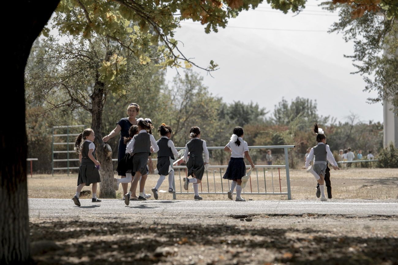 Pupils from a school in Kyrgyzstan crossing a road