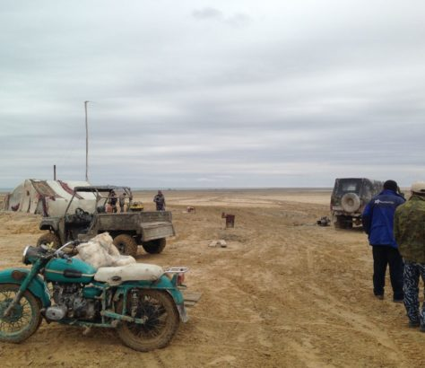 Landscape and fisherman near the Aral Sea.