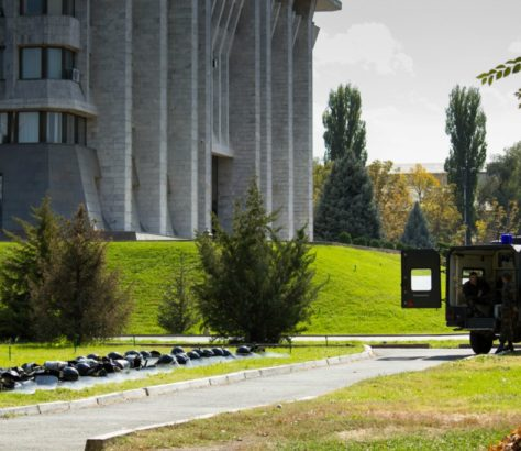 The parliament and presidential building in Kyrgyzstan. On the right, an anti-riot vehicle. 2012.