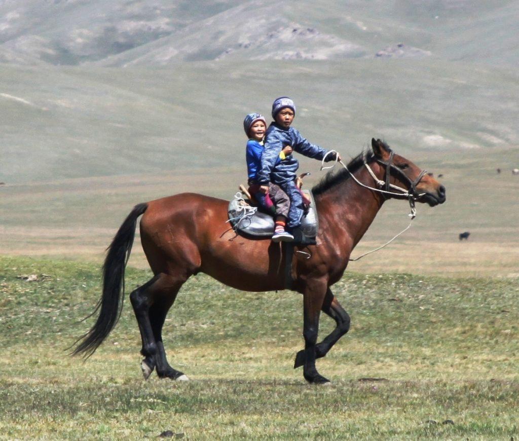 Kyrgyzstan Issyk-Koul Lake siblings horse