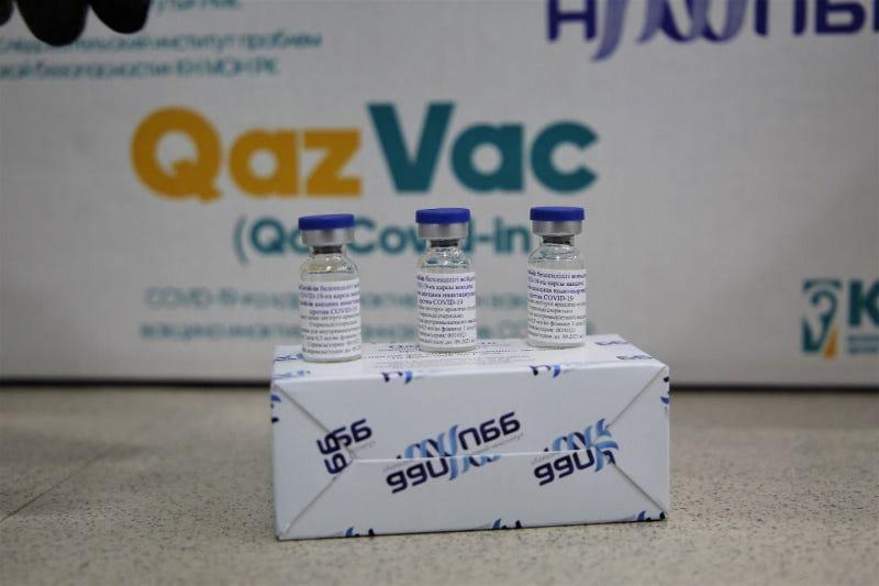 Three bottles of the QazVac vaccine on a box