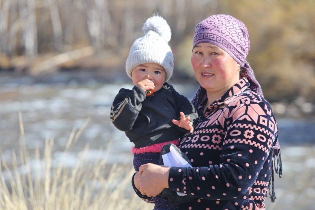A woman and her child: Elnur Kainazarova from the village of Kopura-Bazar, in Kyrgyzstan