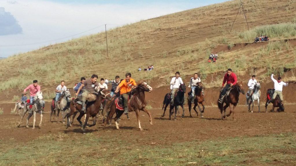 Members of the Van Kyrgyz community play the traditional game Kok-Boru.