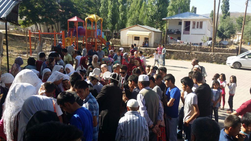 The Ulupamir community gathers for a celebration.