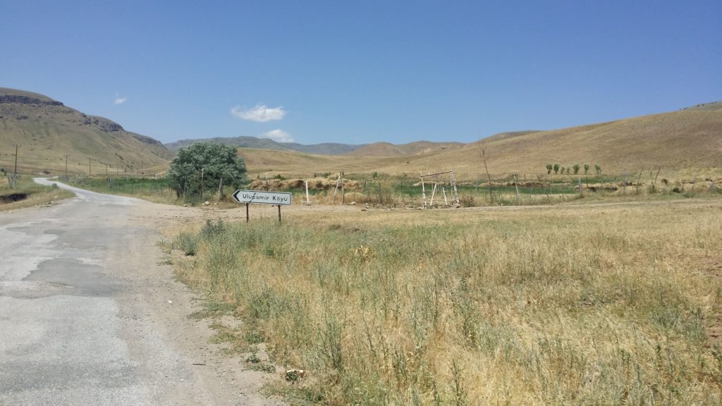 A sign post points towards the village of Ulupamir.