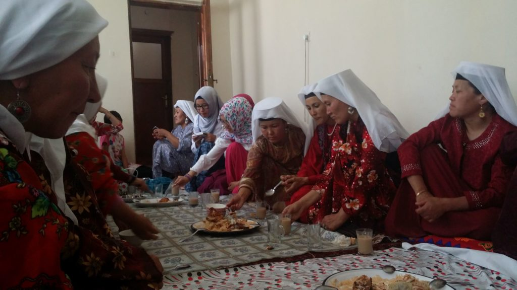 Van Kyrgyz women gather to eat.