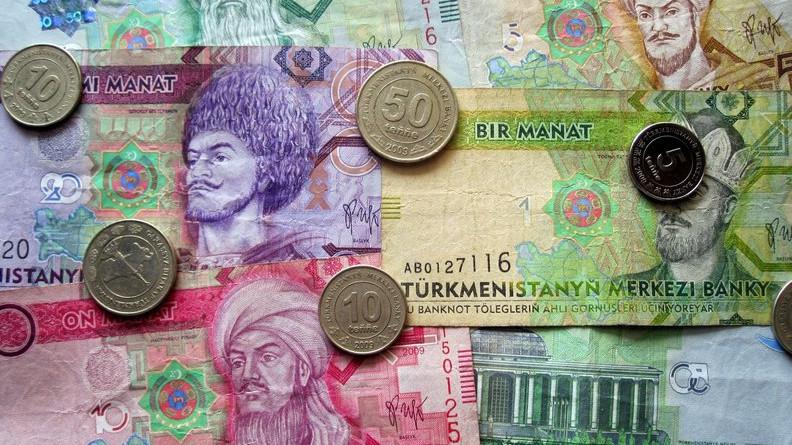 Billets et pièces de la monnaie turkmène, le manat